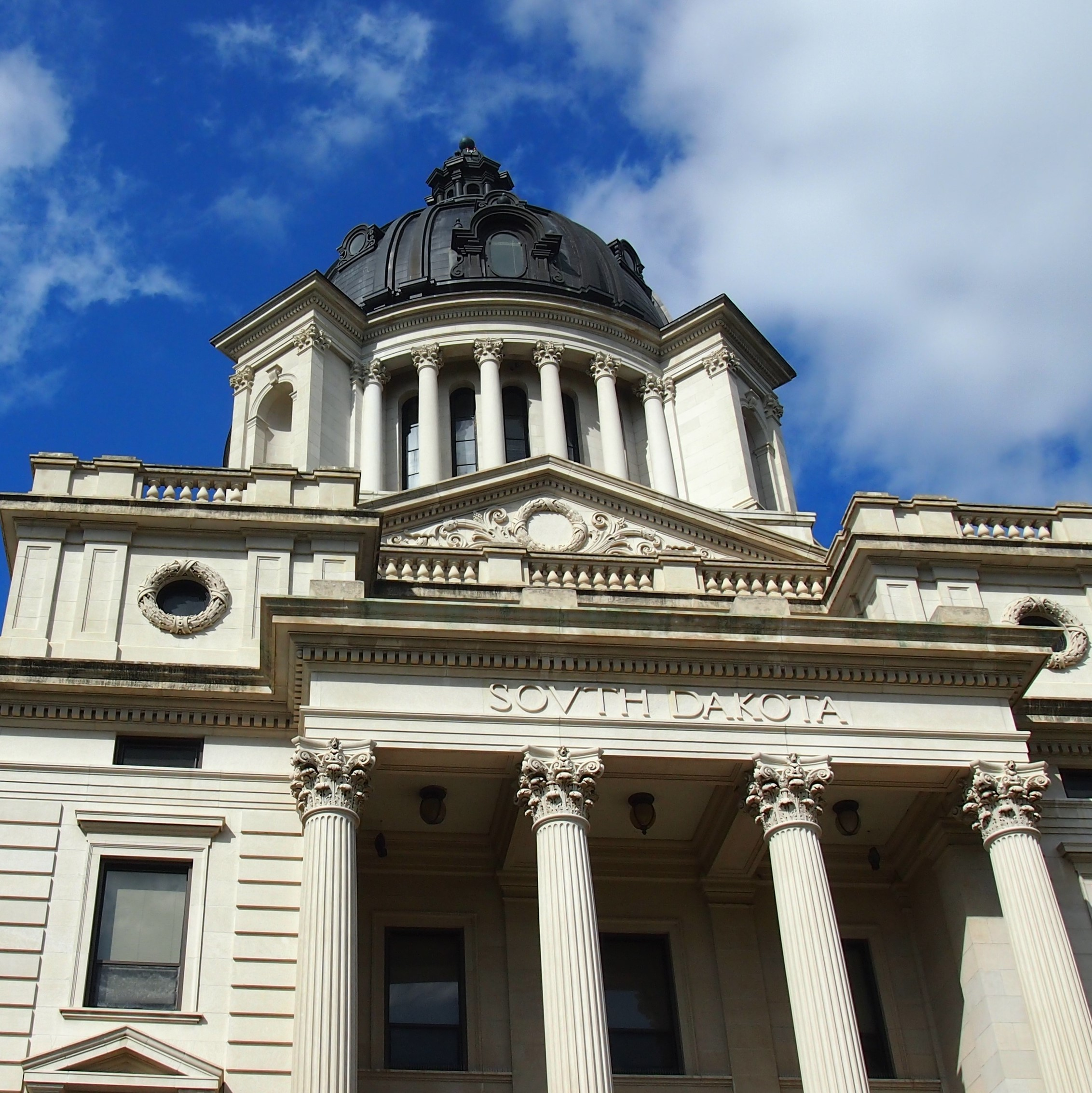 South_Dakota_State_Capitol_front_with_clouds